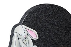 "This circular headstone is further shaped around the sandblasted and painted bunny - shown in flint grey granite.headstone 16"" (h) x 22"" (w) x 3"" (d)Base 3"" (h) x 24"" (w) x 12"" (d)Product code -  16176"