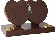 "An elegant double heart memorial linked by a cnc carved and painted rose - shown in ruby red granite.tablet 16"" (h) x 28"" (w) x 3"" (d)rest 12"" (h) x 6"" (w) x 3"" (d)Base 3"" (h) x 30"" (w) x 15"" (d)Product code -  16105"