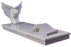 "This beautiful memorial which features a hand carved angel with outspread wings and a scroll tablet for inscription - shown in grey bird granite. Overall 36"" (h) x 34"" (w) x 82"" (d) Product code - 16084"